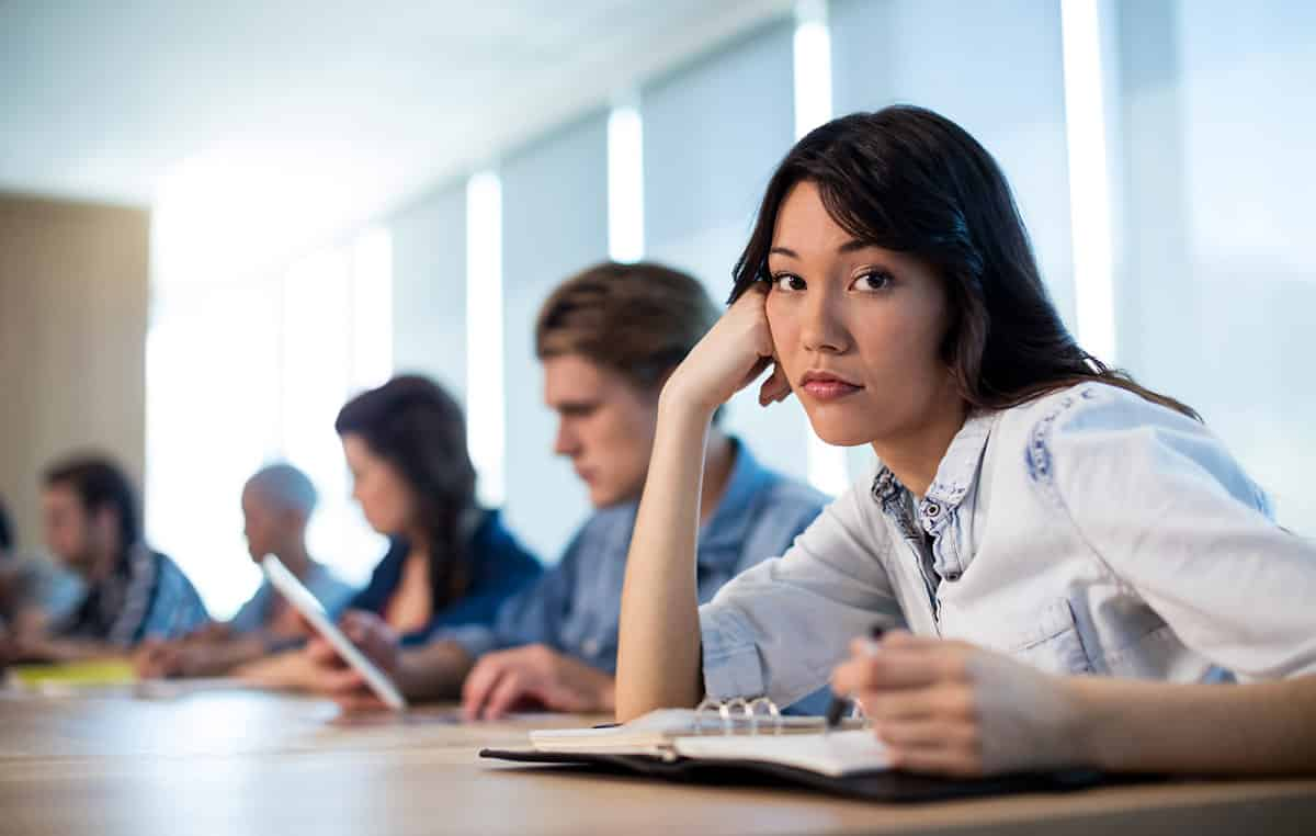 woman looking bored in a meeting