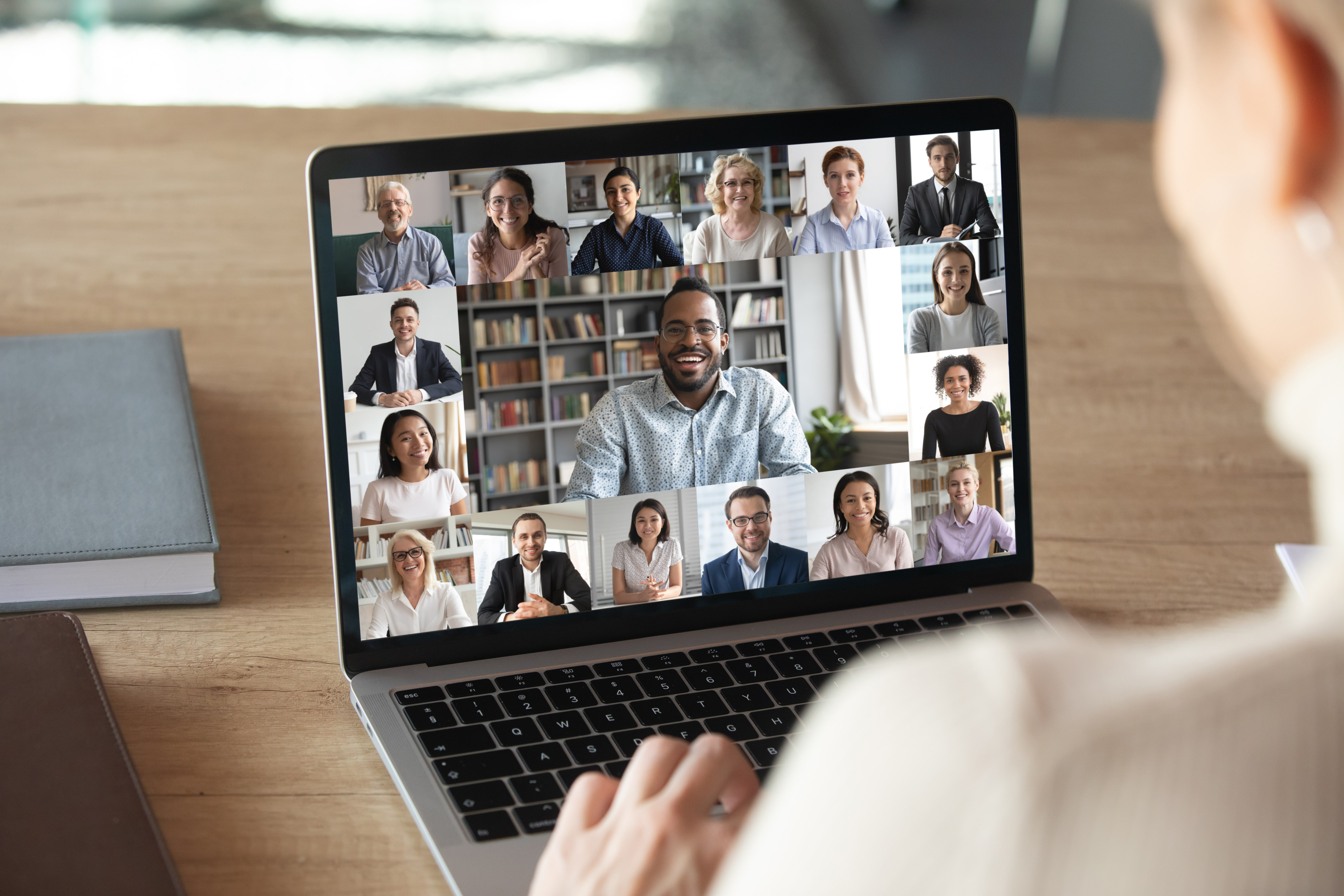woman-on-video-call-with-friends-on-laptop