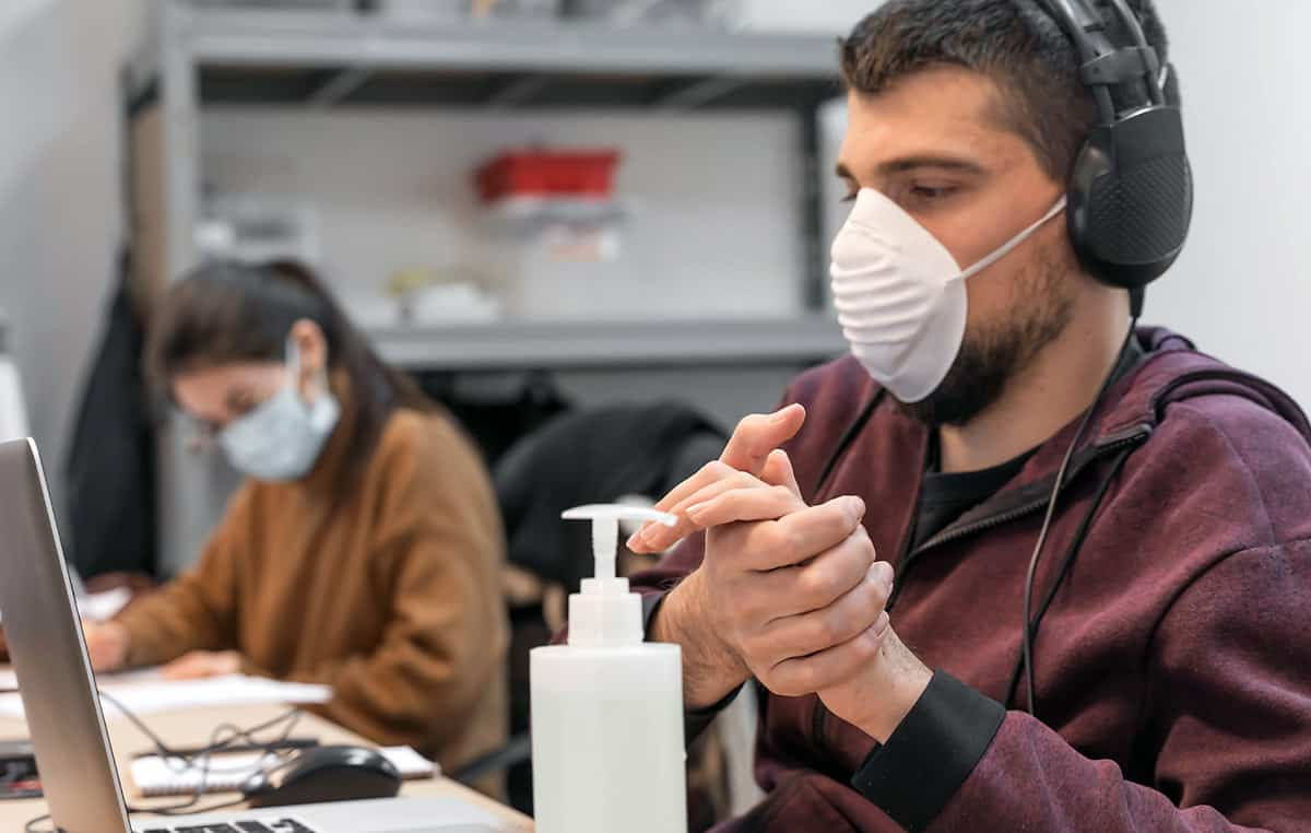 people working in office wearing face masks