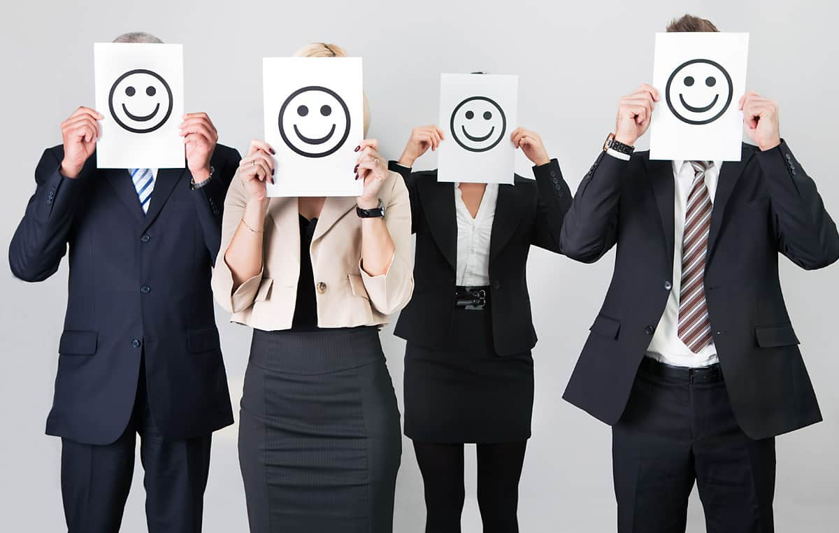 business people smiley faces