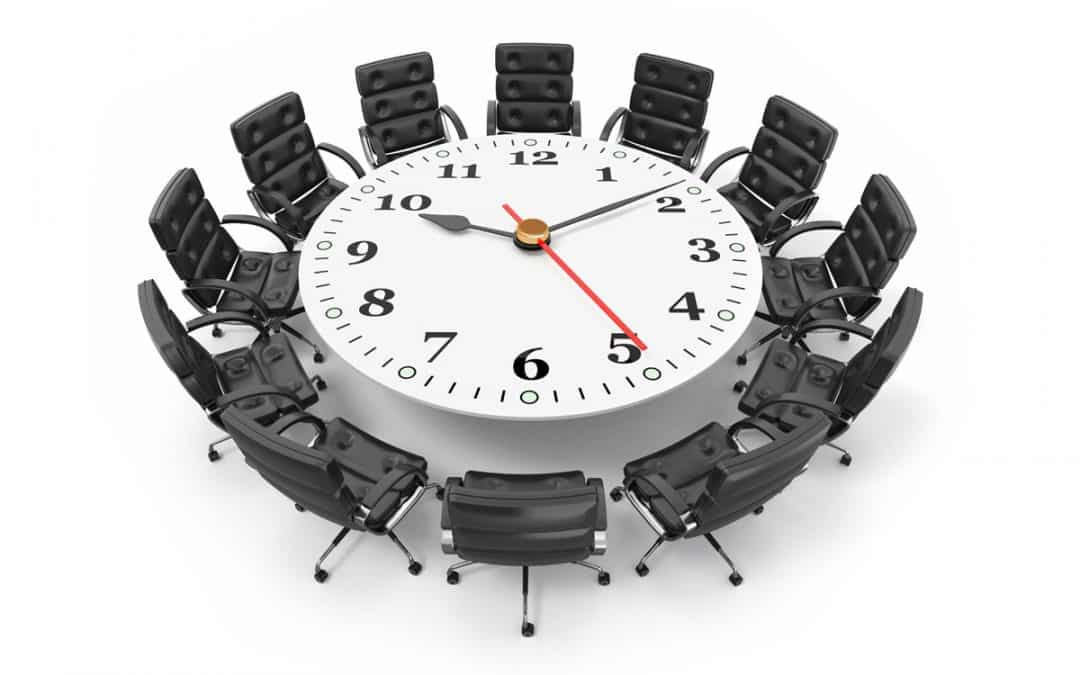 meeting room table with a clock