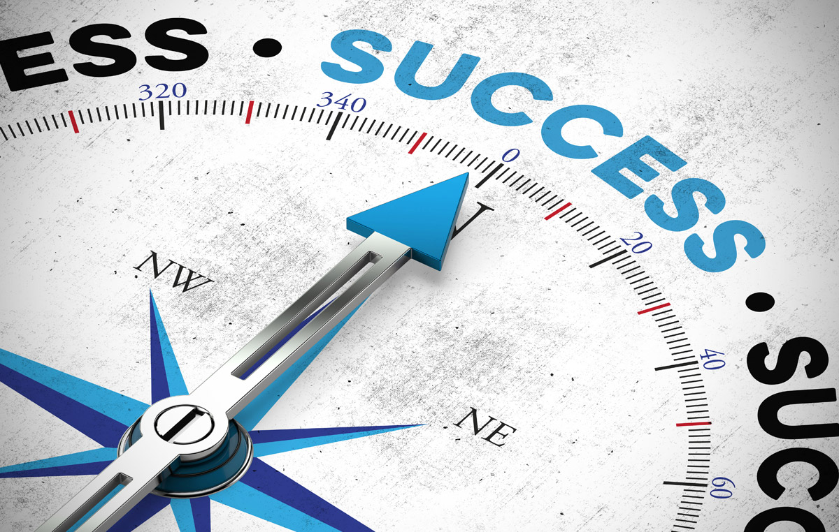 image of a compass pointing towards the word success